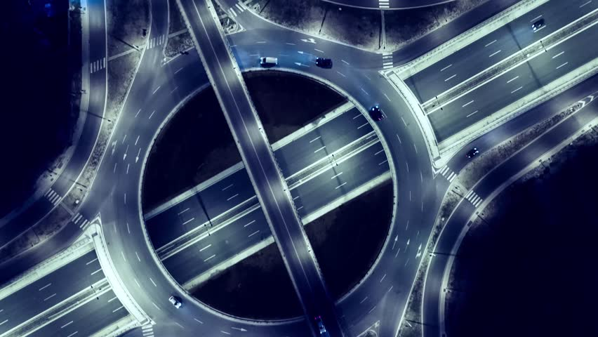 Elevated Road Junction And Interchange Overpass  At Night Traffic Timelapse Transportation Light Dark Illuminated Modern Urban Office Building | Shutterstock HD Video #21762709