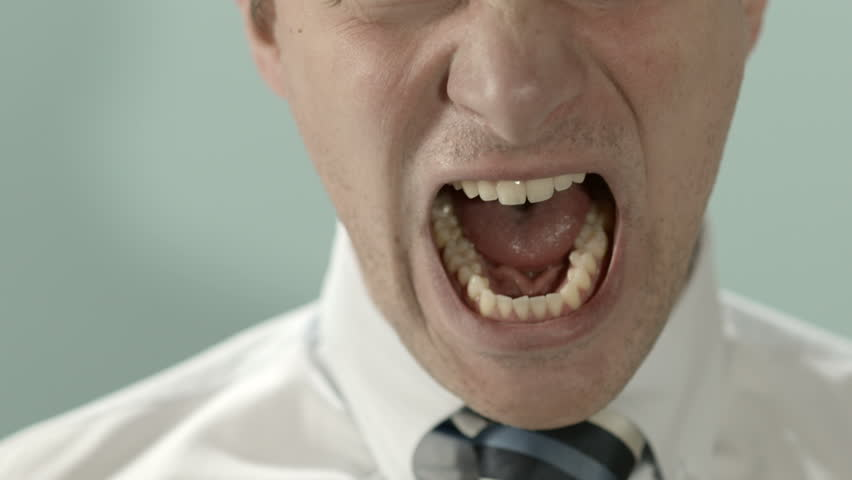 Close-up of angry businessman screaming against blue background. Copy space #2179684
