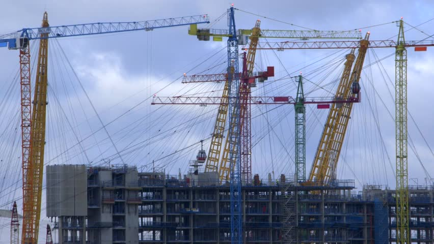 Construction crane frenzy with passing cable cars - time lapse, London UK building site, post Brexit, 7 November 2016