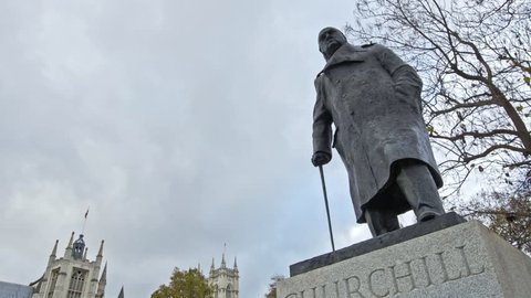 a panned walking shot of Winston Churchill in parliament square, London, England, united kingdom