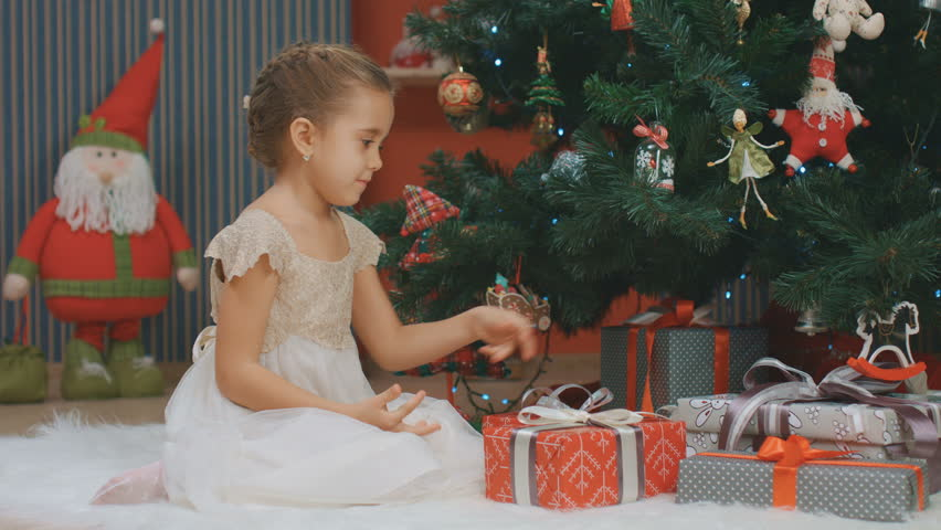 Family Around Christmas Tree Part - 16: A Little Girl Finds A Gift Under The Christmas Tree And Opens It, New -