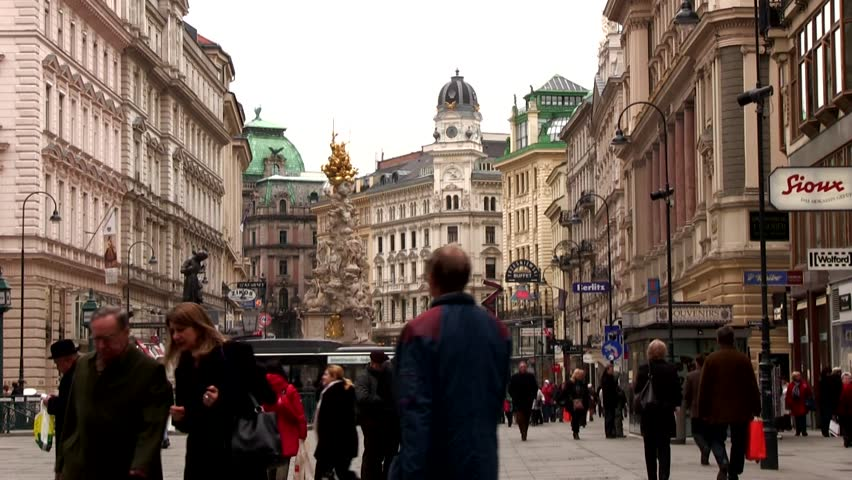 VIENNA, AUSTRIA - APRIL 12: People walk through Graben, one of the most famous streets in the Vienna city center, on April 12, 2012. The Vienna plaque column (Pestsäule) stands on the Graben, in the Viennese City Center