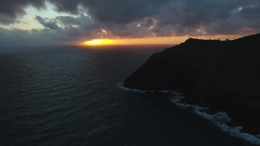 Drone View of Sunrise Sky and Lighthouse Over Ocean