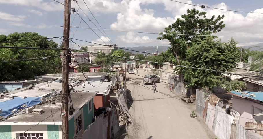 Low altitude aerial flying through a town in Jamaica. | Shutterstock HD Video #21884020