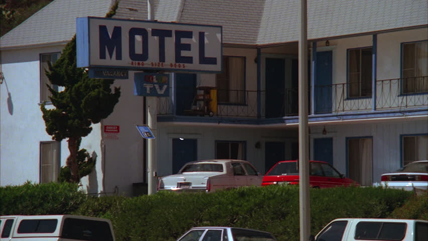 day hold then Pan right over ND 2 story motel, white with dark blue doors trim (Aug 1997)