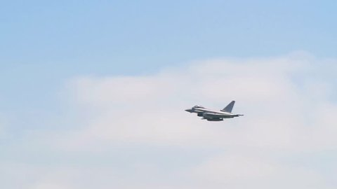 Slow motion display of a multi-role fighter combat aircraft at an air show