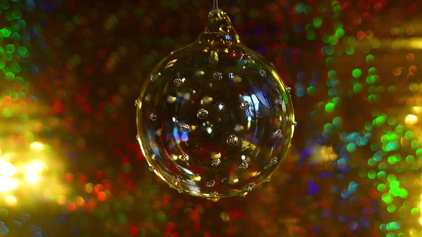 Glass Christmas Bauble rotating on its string . These Christmas Tree Decorations were Shot on a bright and colorful background - Merry Christmas | Shutterstock HD Video #21923287