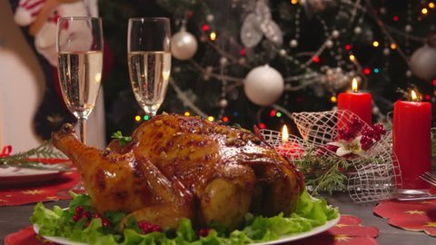 Hot chicken and cold champagne on New Year's table, view from top to bottom