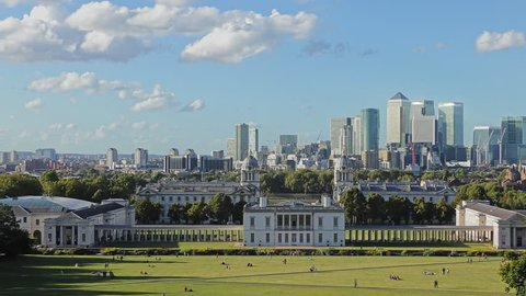Greenwich Park. Time lapse. White clouds float over central London.