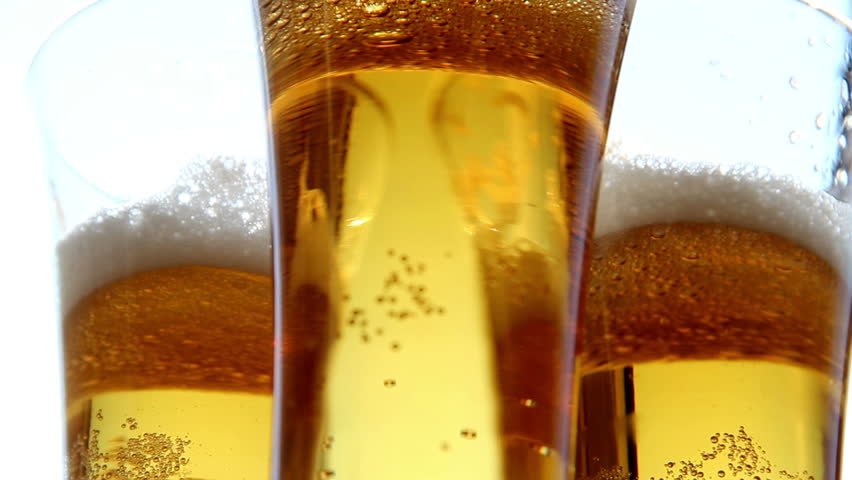 Close up of frosty beer glasses  turning clockwise .