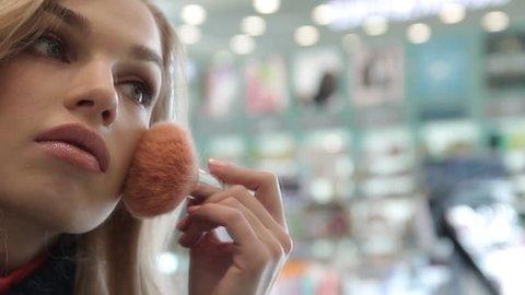 Beautiful girl in a cosmetics store