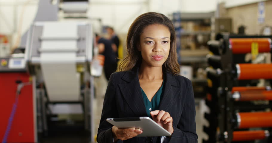 4k, A female warehouse manager with a digital tablet checking inventory.