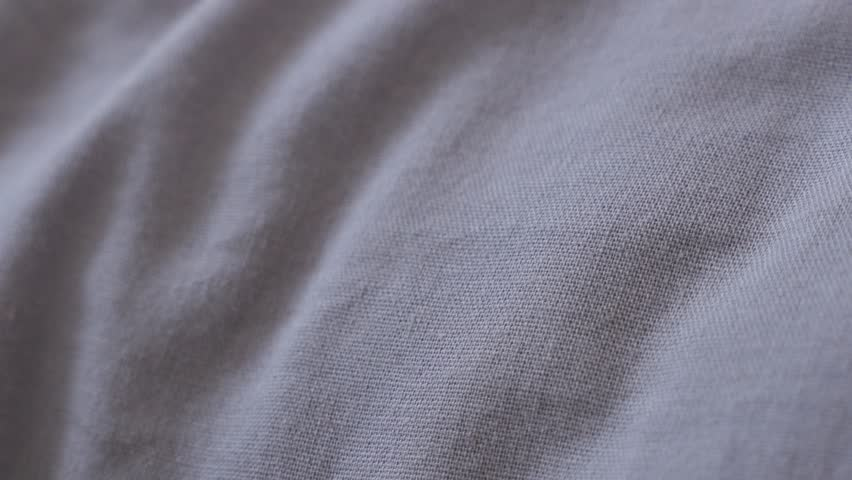 bed sheets texture. Panning Over Fine Cotton Gray Color Bed Sheets 4K 2160p 30fps UltraHD Footage - Close- Texture S