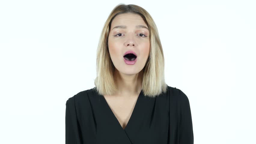 Young Woman Amazed by Surprise, White Background | Shutterstock HD Video #21985360