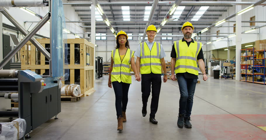 4K Diverse group of workers in modern factory walking directly towards camera & then out of shot. Slow motion. | Shutterstock HD Video #22019380