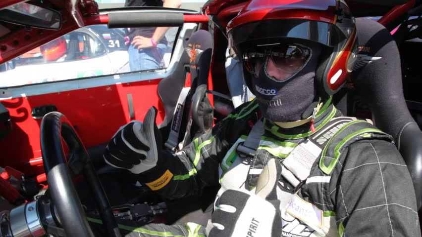 MOSCOW - JUN 11: Pilot sits in car salon, on 3rd stage of championship on drift Megafon-RDS 2011, on Jun 11, 2011 in Moscow, Russia