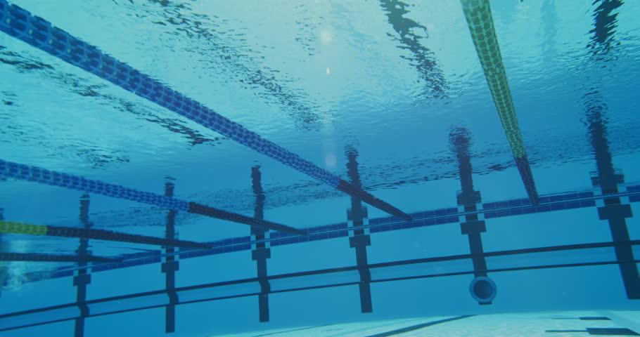 4K Underwater Shaky Slow Mo Of Professional Swimmer Swimming Towards The  Camera   4K Stock