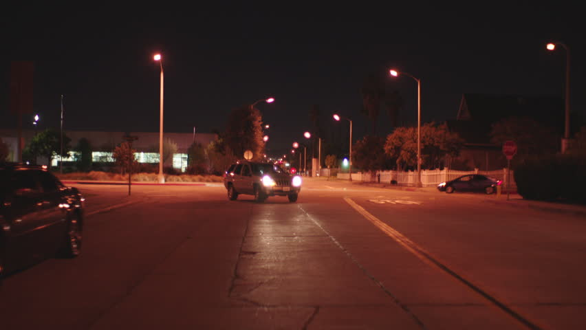 Night process plates moving plates straight back driving city street passing church school then just past crosswalk pull over parked see school crossing sign background has all angles (Nov 2014)   Shutterstock HD Video #22057030
