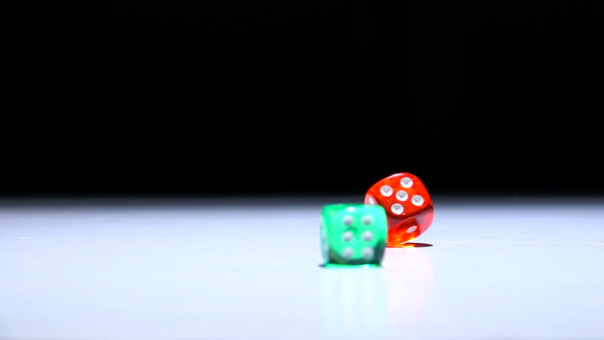 Green and red dice spinning and tumbling. Background film clip with concept of luck and success. | Shutterstock HD Video #22060963
