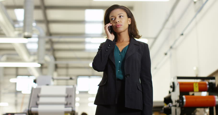 4K Frustrated & annoyed businesswoman in factory dealing with business problems over the phone. Slow motion.   Shutterstock HD Video #22068880