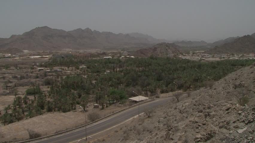 Hatta, Dubai. Pan-left across a view of the town of Hatta in the Hajar Mountains. Hatta is an exclave of Dubai. (Dubai, UAE-2009) | Shutterstock HD Video #22069660