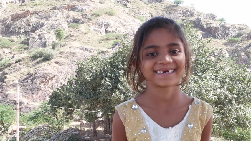 Portrait of lovely little Indian girl with missing teeth