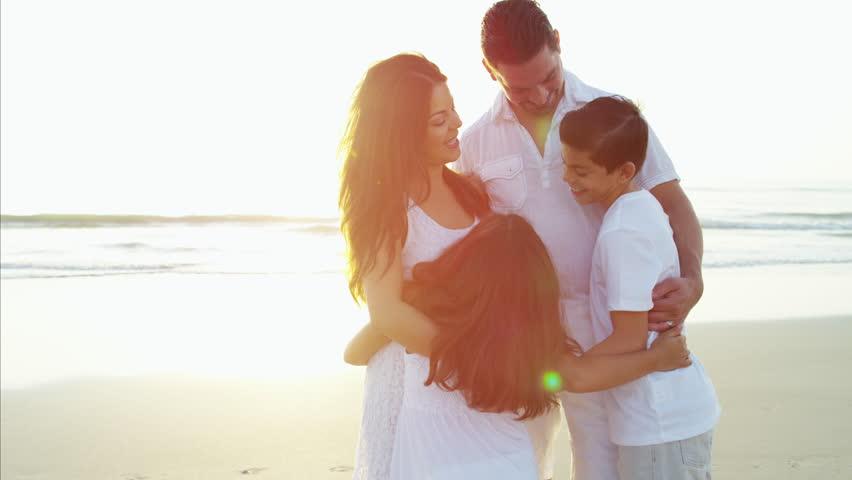 Happy Hispanic children parents playful togetherness leisure tourism Summer vacation ocean beach flare sun RED DRAGON   Shutterstock HD Video #22097530