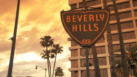 Beverly Hills, California - April 5, 2012: Traffic passes Beverly Hills Sign at Sunset, April 5, 2012 in Beverly Hills, California.