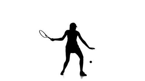 Tennis player hits the ball using a racket. Slow motion. White background. Silhouette