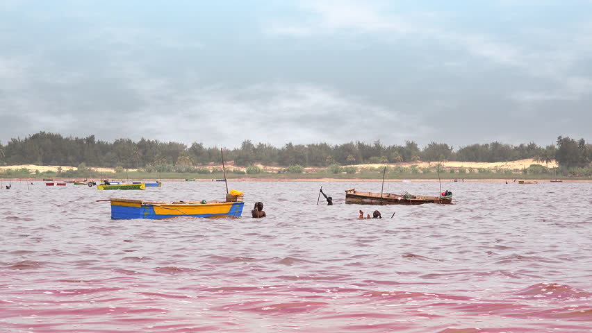 Pink lake, salt collectors - March 2016: Lake Retba, Dakar region, Senegal, Africa