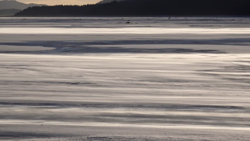 The surface or a frozen wilderness river is held by blasing wind and ice crystals | Shutterstock HD Video #22175020
