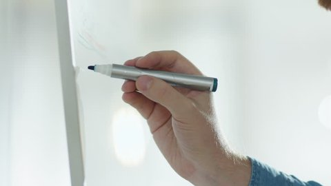 Close-up of a Man's Hand Drawing on a Whiteboard. Shot on RED Cinema Camera in 4K (UHD).