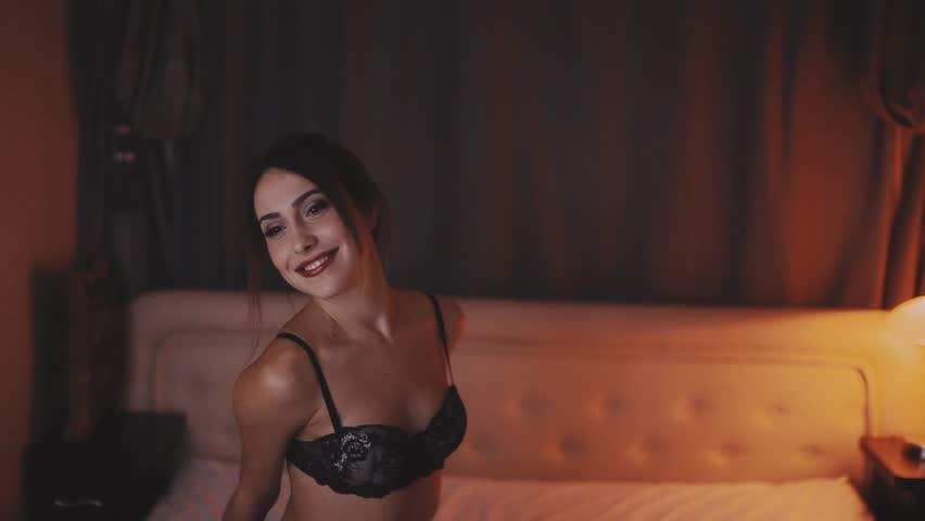 Woman wearing black lingerie brunette