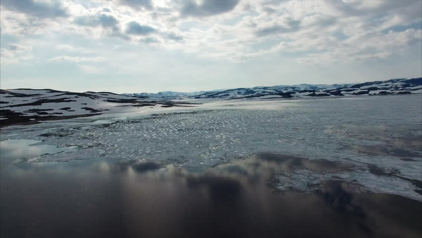 Amazing textures of melting ice on lake in Hardangervidda mountain pass in Norway. | Shutterstock HD Video #22206850