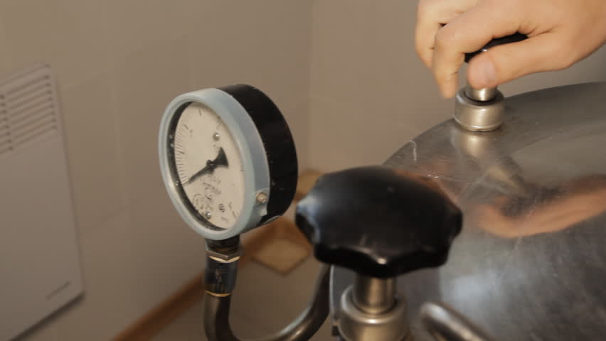 The Autoclave is Closed Tests Male hand in a laboratory autoclave preparation for launch