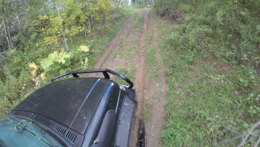 The car goes up in a high hill on a slippery road. Slipping wheels. GoPro. | Shutterstock HD Video #22257412