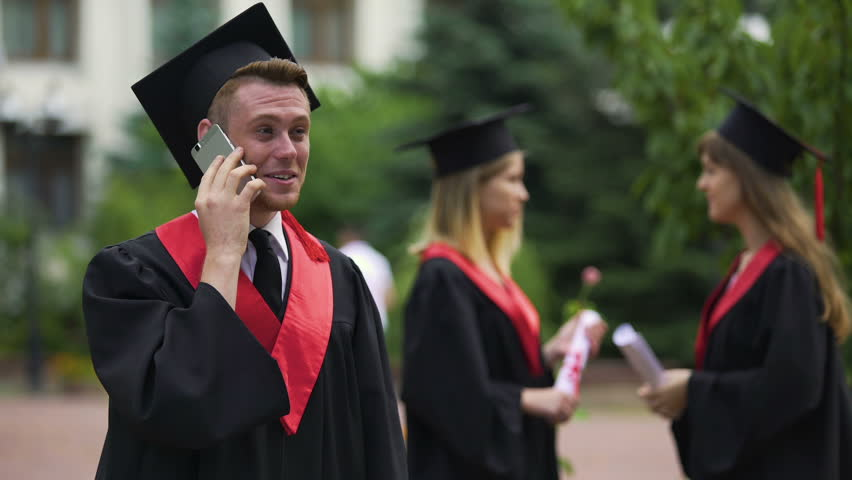 Happy male graduate receiving prestigious job offer, telephone conservation | Shutterstock HD Video #22260790
