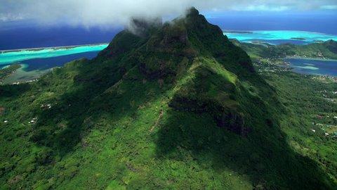 Aerial Bora Bora French Polynesia Atoll Tahitian Pacific Ocean Mt Otemanu mountain travel tourism outdoor sky Coastline sun business Mount Pahia