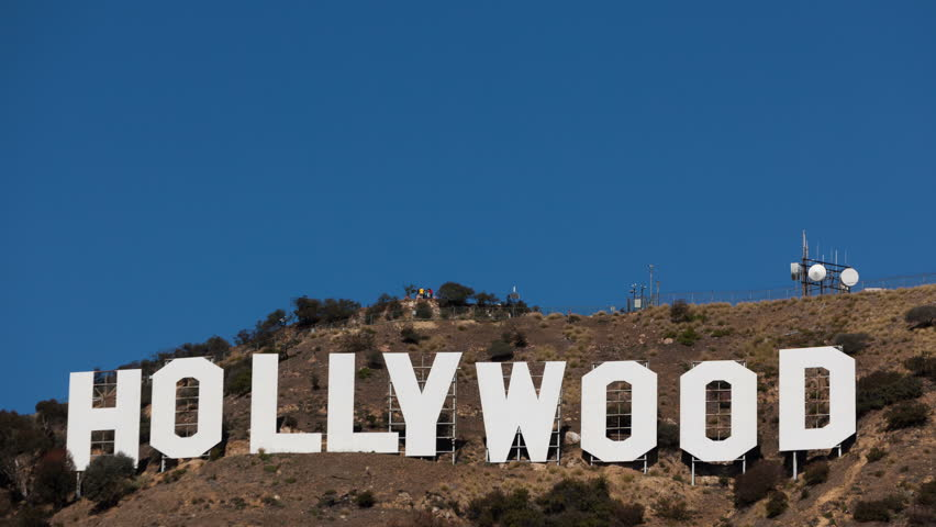 LOS ANGELES, CA, USA - MAR 03, 2012: 4K Time lapse Hollywood sign on Santa Monica mountains with people sightseeing on the platform behind