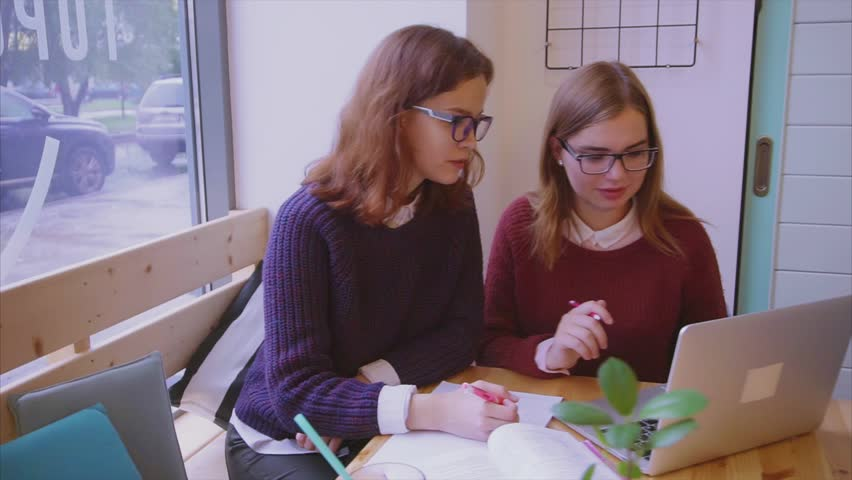 High Quality Female College Students Studies In The Cafe. Two Girls Friends Learning  Together. HD. Part 28