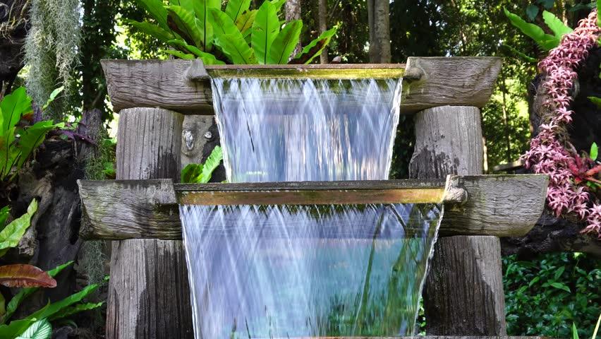 4K Resolution : Small waterfall in garden decorative - 4K stock video clip