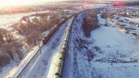 Top view of two freight trains with carriages on railways at winter