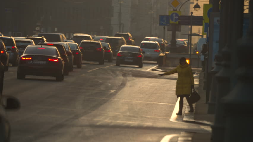 Undefined women is trying to catch the taxi in rush hour  Moscow Russia Twerskaya street October 2015