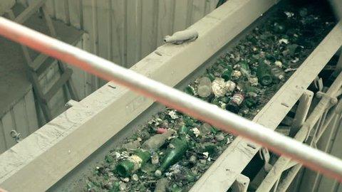 Conveyor belt and glass shredder equipment inside glass recycling factory