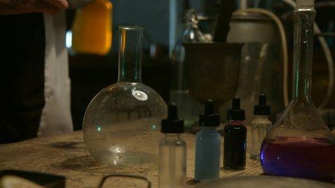 Strange scientist prepares a potion