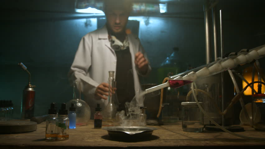The scientist collects gas in the flask after the experiment