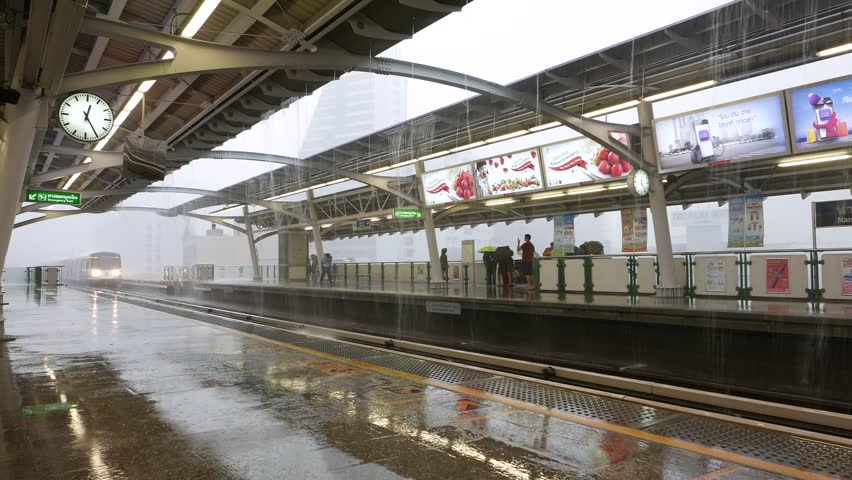 bangkok march 24 2015 skytrain arrive to bts station platform heavy showering - Open Canopy 2015