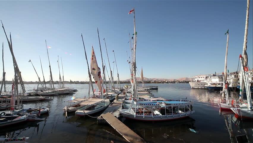 Moored Feluccas & Passenger Ferries; River Nile Luxor Egypt