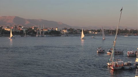 Feluccas & Tourist Boats In Low Sun; River Nile Luxor Egypt