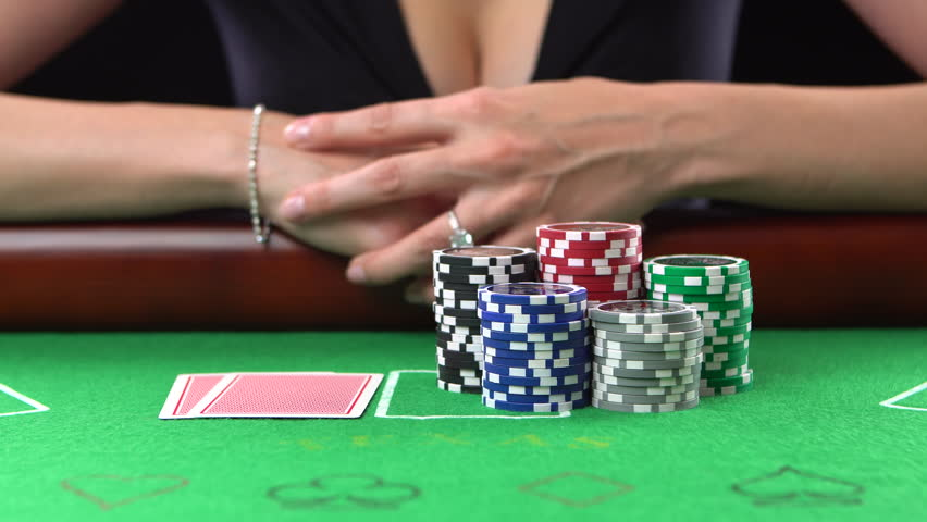 Poker player looking at her cards and goes all-in. Concept of gambling, risk, luck, win, fun, and entertainment. Prores 4k. | Shutterstock HD Video #22425151